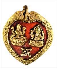 Purpledip Metal Wall Hanging Ganesha-Lakshmi: Auspicious Hindu Symbols on Betel Leaf (11542)