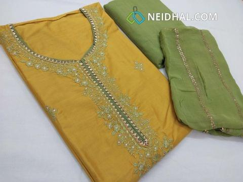 Designer Mehandi Yellow Soft Silk Cotton unstitched salwar material(requires lining) with zari and thread embroidery work on front side, drum dyed green cotton Bottom, sequence work on pure chiffon dupatta with fancy tapings.