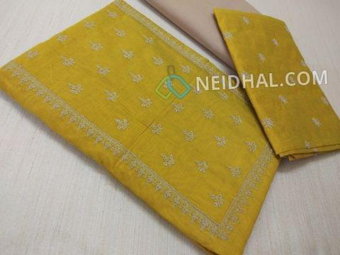 Mehandi Green Silk cotton unstiched salwar material(requires lining) with embroidery work on yoke, embroidery work on front side, plain back, beige cotton bottom, Mehandi Green silk cotton dupatta with embroidery work taping
