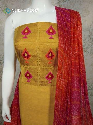 Yellow Silk Cotton unstitched salwar material(requires lining) with embroidery work on yoke, plain back side, pink Cotton bottom, Bandhini printed chiffon dupatta with tapings