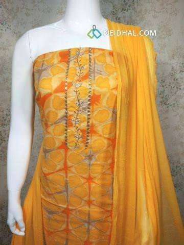 Printed Yellow and orange Cotton unstitched salwar material with pipe and bead work on yoke, yellow Cotton bottom, yellow chiffon dupatta with tassels