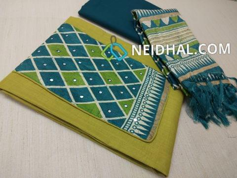 Green Soft Slub Cotton unstitched salwar material(requires lining) with Art silk patch on yoke, daman patch, Blue cotton bottom, Printed semi art silk dupatta with tassels.