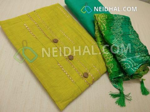 Designer Green Silk cotton unstitched salwar material(requires lining) with fancy buttons, pintuck work on sides, fancy golden stitch inserts on front side, plan back, Turquoise silk cotton bottom, Bandhini printed Crush silk short width dupatta