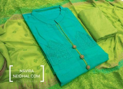 Designer Turquoise Blue Chanderi unstitched salwar material(requires lining) with Embroidery work and neck design, fancy buttons on yoke, daman patch, silk cotton bottom, Block prints on chiffon dupatta with tappings.