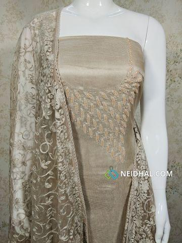 Designer Beige modal(Super Net) Fabric unstitched salwar material(requires lining) with heavy pipe work and Bead work on yoke, Drum dyed Beige Soft silk cotton bottom, Thread work on super net dupatta with lace taping.