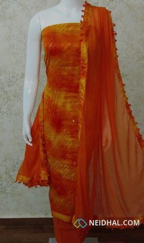 Orange Satin Cotton unstitched Salwar material with foil mirror work, orange cotton bottom,  orange chiffon dupatta with pom pom tapings