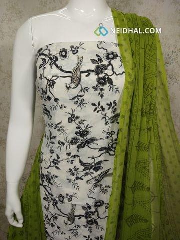 Printed White Cotton Unstitched salwar material with golden prints, green cotton bottom, printed green chiffon dupatta with tapings.