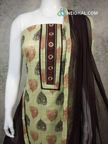 Leaf Printed Green Cotton unstitched Salwar material(requires lining) with thread and foil mirror work on yoke, brown cotton bottom, brown chiffon dupatta with tapings.