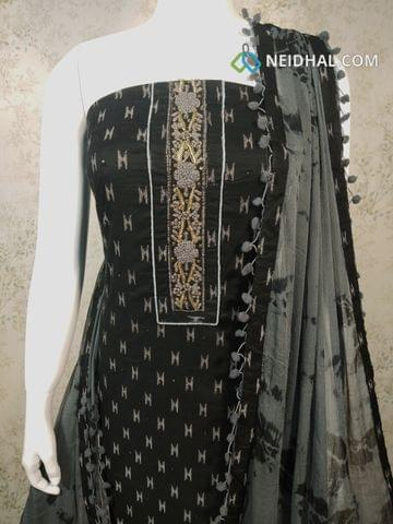 Ikkat Printed Black Cotton Unstitched salwar material with mini stone and french knot work on yoke, grey cotton bottom, grey chiffon dupatta with pom pom tapings.