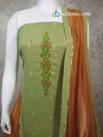 Printed Light Green Slub Cotton Unstitched salwar material with french knot, bead, foil mirror work on yoke, fenu greek yellow cotton bottom, fenu greek yellow chiffon dupatta with tapings.