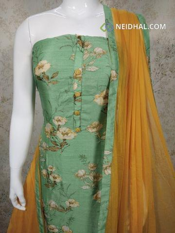 Digital Printed Sea Green Soft Slub Silk Cotton Unstitched salwar material(requires lining) with zari thread work on front side, fenu yellowcotton bottom, fenu greek yellow chiffon dupatta with tappings.
