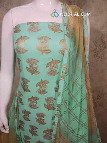 Turquoise Blue Slub Cotton unstitched salwar material with golden prints, golden printed beige cotton bottom, Golden Printed dual color chiffon dupatta with tapings.