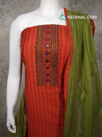 Orange Silk Cotton unstitched Salwar material with foil mirror, french knot, bead work on yoke, plain back side, green cotton bottom, embroidery work on green chiffon dupatta with tapings.