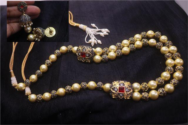 Buy this Precious Pearl + Precious Beads necklace