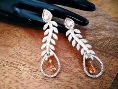 American Diamond earring with an year warranty