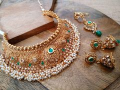 High quality gold plated necklace set studded with Kundan Stones with an year warranty