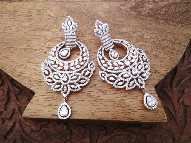 High class Gold plated earring studded with American Diamond . 1 year warranty