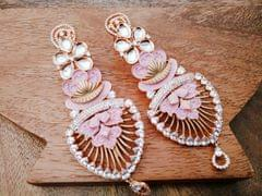 Rose Coloured beautiful pair of  silver plated American Diamond earrings with an year warranty