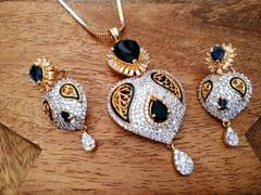 Buy this beautiful heart shaped Necklace set studded with American Diamond Stone