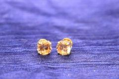 White coloured American Diamond Stud with an year warranty